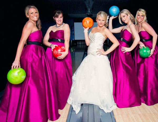 Bridal party holding bowling balls