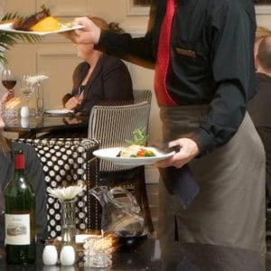 Thumbnail of http://Waiter%20serving%20food